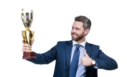 Reward for work. Happy ceo show thumbs up to golden cup. Reward and recognition. Cup winner. Business achievement award. The best you can get.