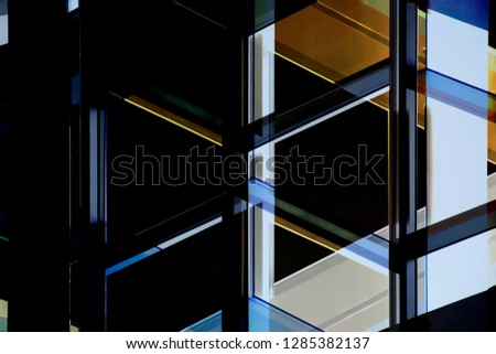 Reworked close-up photo of office building fragment in shadows against clear blue sky. Abstract modern architecture background on the subject of structural glazing. Glass walls with metal framework. #1285382137