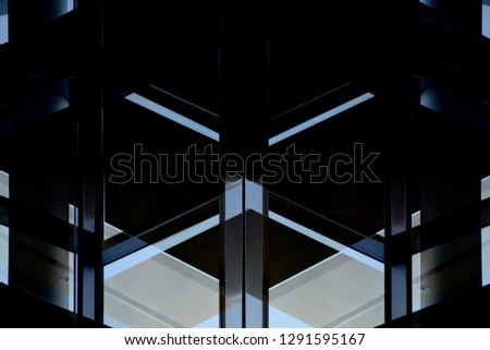 Reworked close-up photo of office building fragment with structural glazing. Glass walls with metal framework. Darkness inside and bright blue sky outside. Abstract modern architecture background. #1291595167