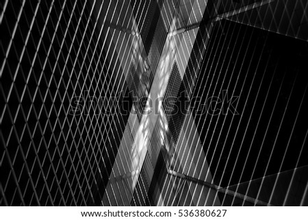 Reworked close-up photo of pitched ceiling / roof with louvered structure. Modern architecture. Abstract black and white background image on the subject of office or industrial interior.