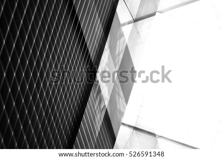 Reworked modern architecture photo featuring spacious empty area for text placement. Abstract business interior in minimalism or hi-tech design. Tilt black-and-white photo with checkered wall panels.