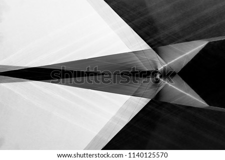 Reworked photo of matte wall panels. Office building exterior fragments in soft backlight. Abstract modern architecture background in black and white. Architectural surfaces.