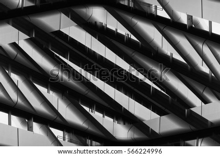 Reworked photo of office building fragment with balconies. Abstract black and white image on the subject of modern architecture / commercial real estate. Industry or technology motif.