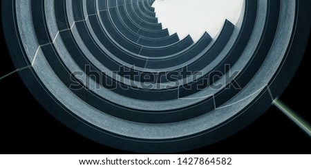 Reworked underside view of curvilinear balconies. Modern architecture seen from low angle. Hi-rise building exterior. Modular architectural structure of multistory house. Round geometric composition.