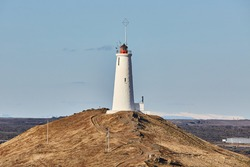 Reykjanes Lighthouse in Iceland with Gunnuhver geotermal area in the background