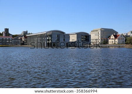 Reykjavik, Iceland - August 7, 2015: Lake Tjornin with the new City Hall, which was built in 1992. Its located in the heart of Reykjavik. #358366994