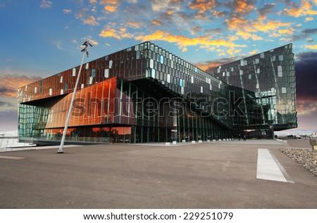 REYKJAVIK, ICELAND - JUNY 9: Twilight scene of Harpa Concert Hall in Reykjavik harbor, Iceland late evening of Juny 9, 2013. The Harpa Concert Hall is the new landmark of the city, build in 2011