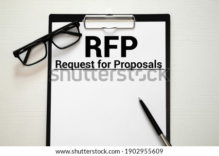 RFP- Request For Proposal written in notebook. Сток-фото ©