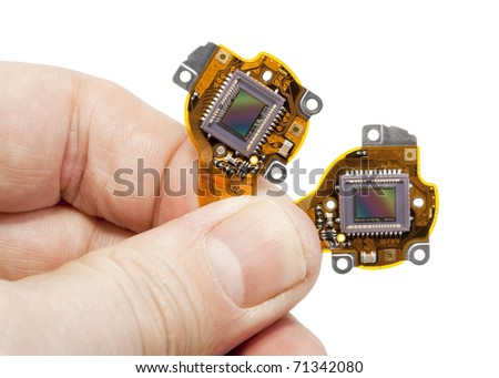 RGB  image  sensors from the  modern mass compact digital camera  in hand. Isolated on white with patch
