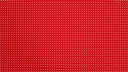 RGB LED screen panel texture. Close-up of a pixel LED screen with bokeh for wallpaper. Bright red abstract background perfect for any design.