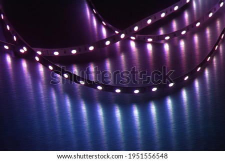 RGB led strip light on metallic background illumination in blue color, electric devise Stock photo ©