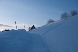 Rhe wintery village and the blue sky