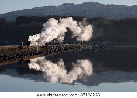 Rheilffordd Ffestiniog steam railway and train in winter with lots of steam Porthmadog North Wales