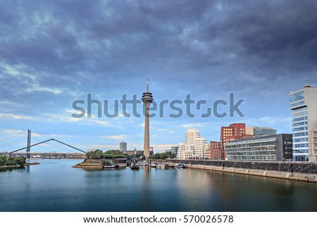 Rhine river boardwalk with view on Dusseldorf city in Germany #570026578