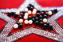 Rhinestones on fabric, background and texture for design.
