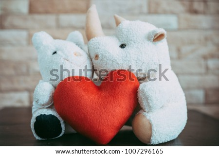 Rhinoceros doll and cow doll  with red heart shape,Valentine's Day concept. #1007296165