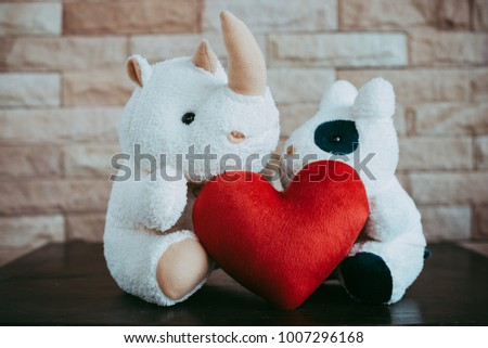Rhinoceros doll and cow doll  with red heart shape,Valentine's Day concept. #1007296168