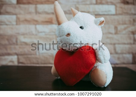 Rhinoceros doll holding a red heart shape,Valentine's Day concept. wait love. #1007291020