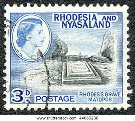 RHODESIA and NYASALAND - CIRCA 1959: Stamp printed by the British administration showing Rhodes's grave at Matopos, Bulawayo, Zimbabwe, circa 1959