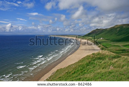 Rhossili Bay Gower South wales UK - Surf hotspot, with paraglider. No people on beach