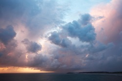 Rhossili Bay Sunset on Gower Peninsular with high tide and cloudscape