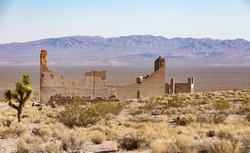 Rhyolite is a ghost town in Nye County, in the U.S. state of Nevada. It is in the Bullfrog Hills, about 120 miles (190km) northwest of Las Vegas, near the eastern edge of Death Valley.