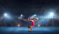 Rhythmic gymnast in professional arena.