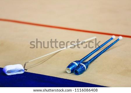 Rhythmic gymnastics ribbon and clubs