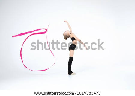 Rhythmic gymnastics white caucasian cute beautiful girl execute pivots and pirouettes during dancing in black suit with pink ribbon showing agility and flexibility on white background isolated