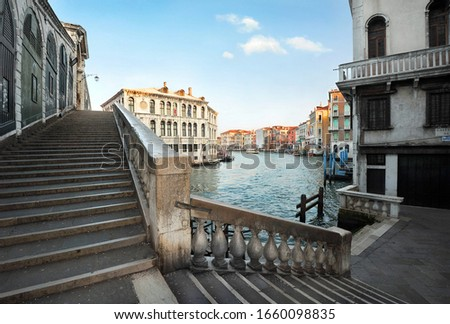 Rialto Bridge and Grand Canal, Venice, Italy - empty staircase and embankment in famous italian city