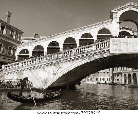 Rialto bridge with gondola, Venice, Italy