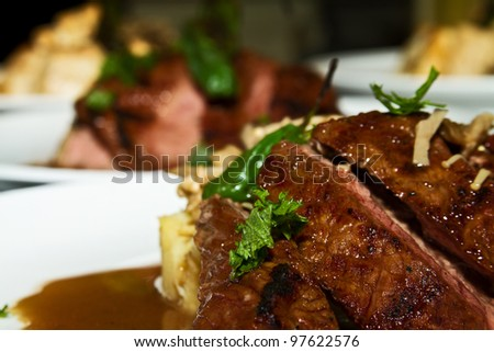 Rib Eye and Ginger Parsnips - stock photo