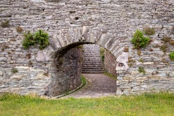 Ribadeo / Spain - July 08 2020: Stone passageway leading to a staircase in the wall of San Damian Castle in Ribadeo Spain