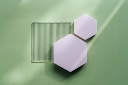 Ribbed acrylic plate and hexagon  on green background with  shadow. Stylish background for presentation.
