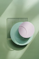 Ribbed acrylic plate and round platforms on green background with  shadow. Stylish background for presentation.