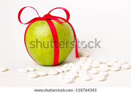 Ribbed green apple with tablets