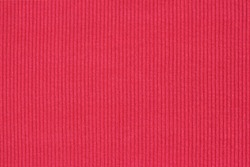 Ribbed textile material, in fine-knit stretch fabric.Knitwear texture. Amaranth color background.
