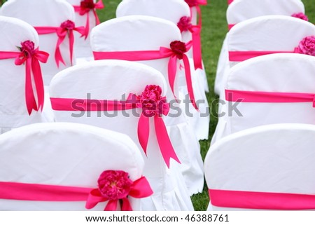 stock photo Ribbon decoration on wedding chairs cover