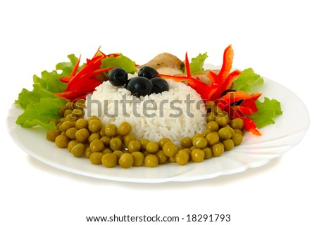 Rice and fried chicken with vegetable (lettuce, pepper,  olives and green peas) decoration.
