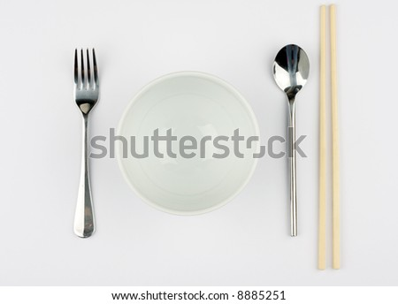 Rice and noodle bowl against a white tablecloth - stock photo