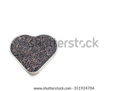 Rice berry in the heart box on the white background #351924704