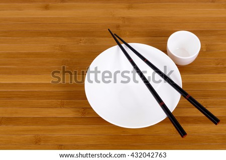 Rice bowl and japanese sake cup with chopsticks  #432042763
