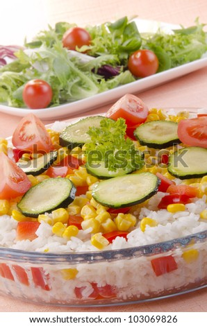 Rice bowl with diced peppers, sweet corn and zucchini