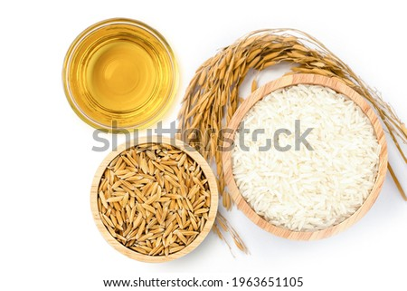 Rice bran oil extract with white rice and paddy rice isolated on white background. Top view. Flat lay.
