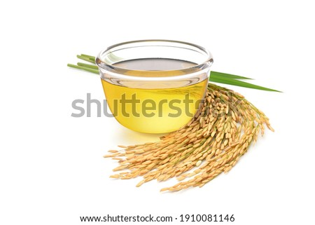 Rice bran oil with rice ears and leaves  isolated on white background.
