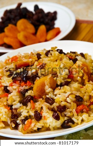Rice, carrots and dried fruits.
