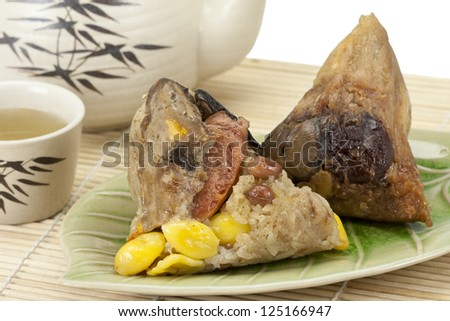 Rice dumplings or zongzi with tea
