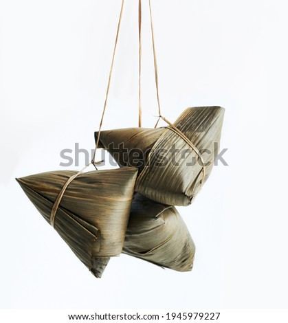 Rice dumplings, zongzi - Chinese rice dumplings isolated on white background, concept of Dragon Boat Festival traditional food, close up.