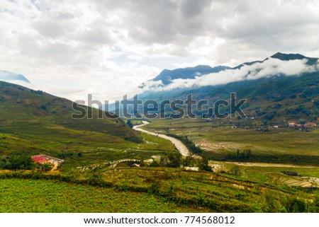 Rice fields on terraced mountain farm landscapes Lao Cai province, Sapa Viet Nam, Northwest Vietnam. Natural travel background. #774568012