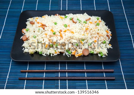 rice fried with vegetables in a salver with toothpicks